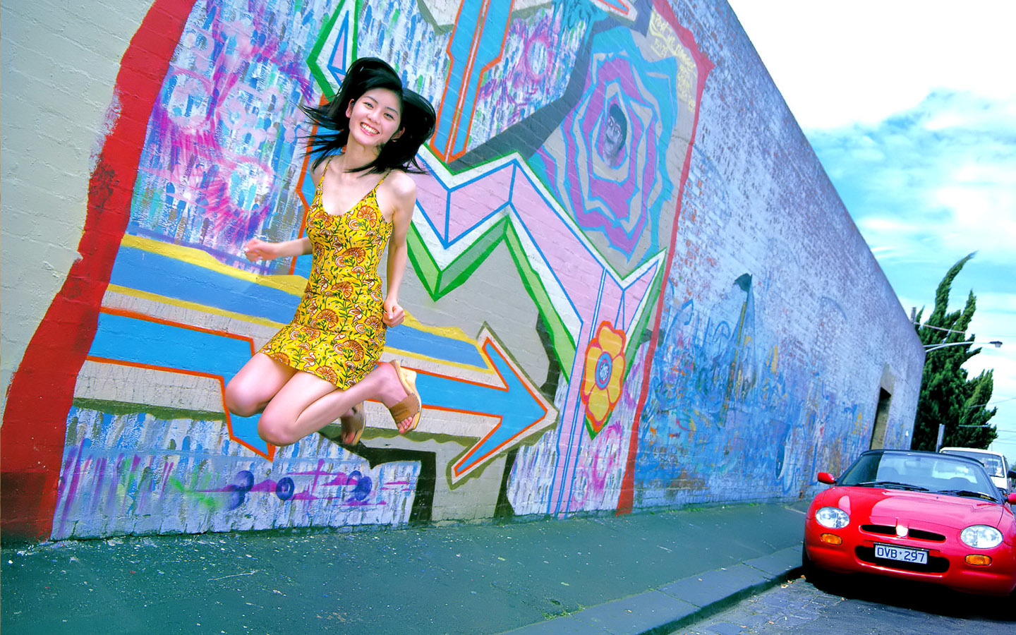 asian girl jumping sidewalk HD Wallpaper