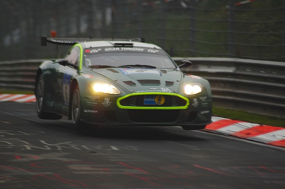 cars Aston Martin jumping HD Wallpaper