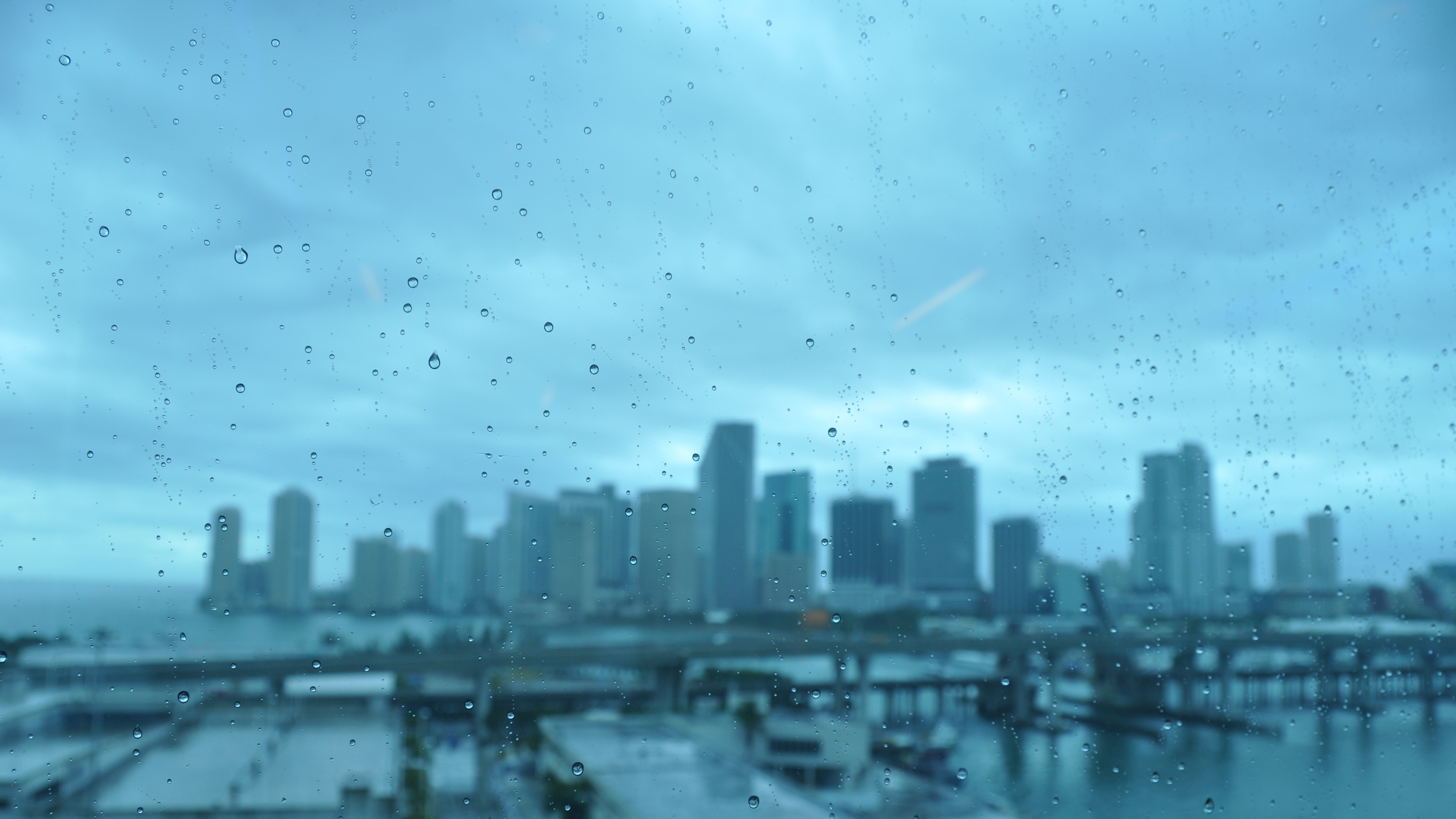 cityscapes rain on glass HD Wallpaper