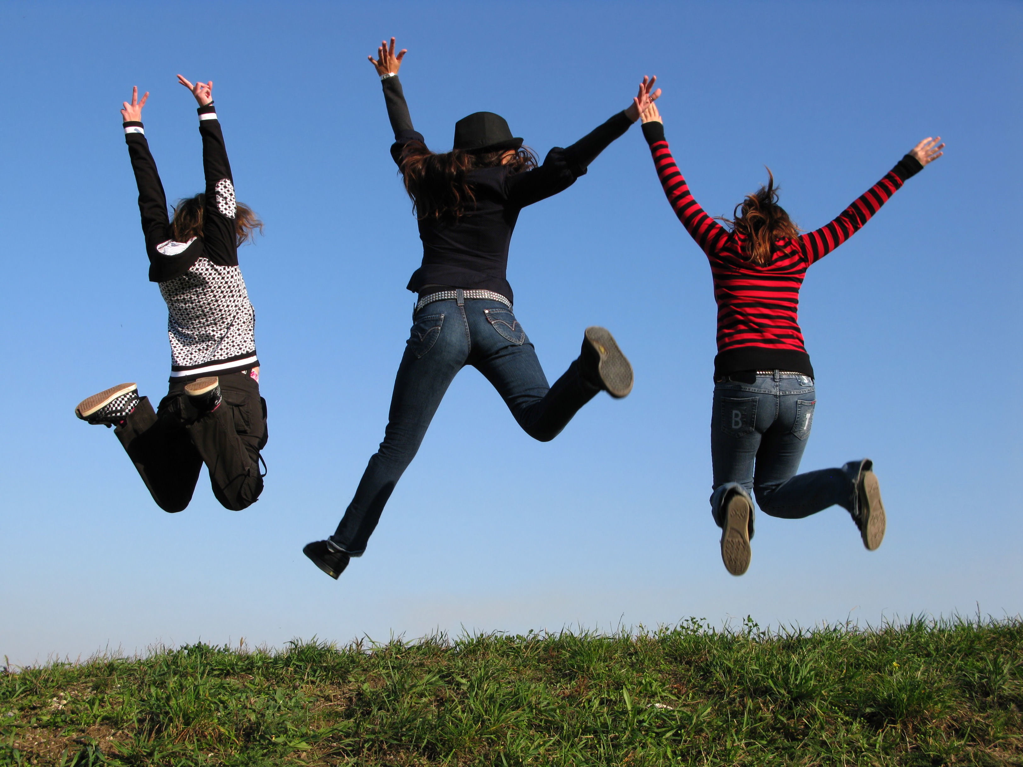 jeans grass jumping Arms HD Wallpaper