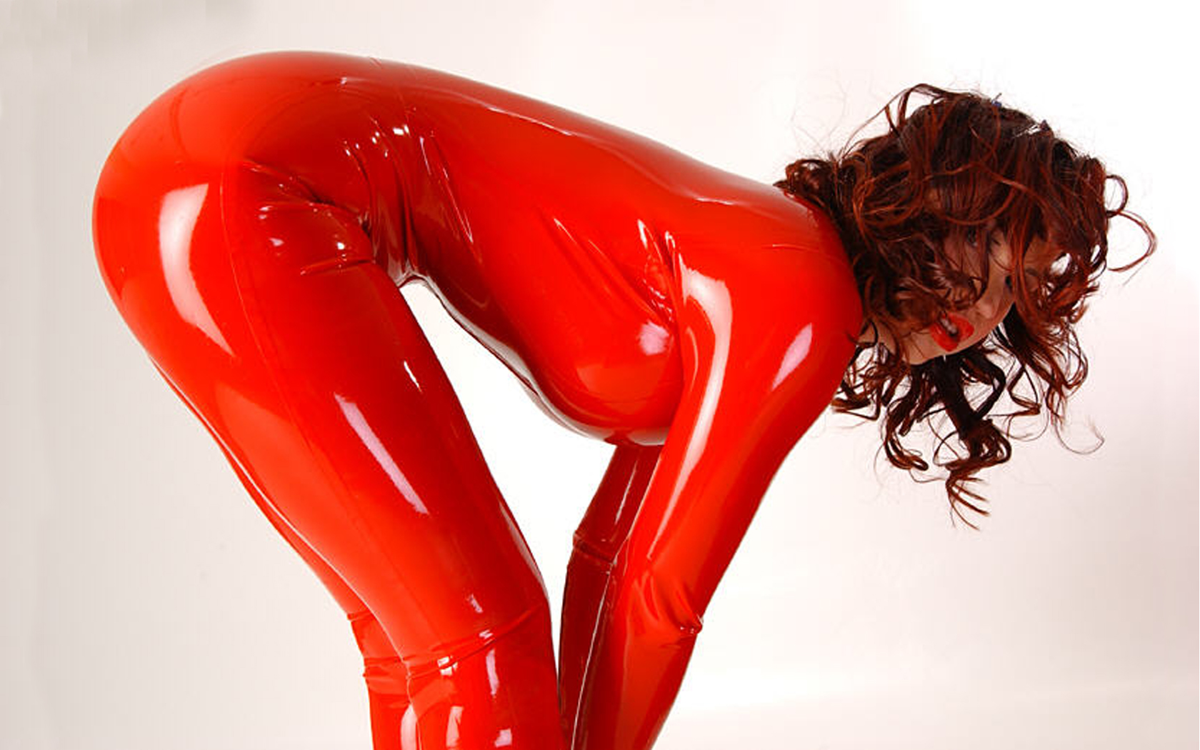 latex catsuits bent over