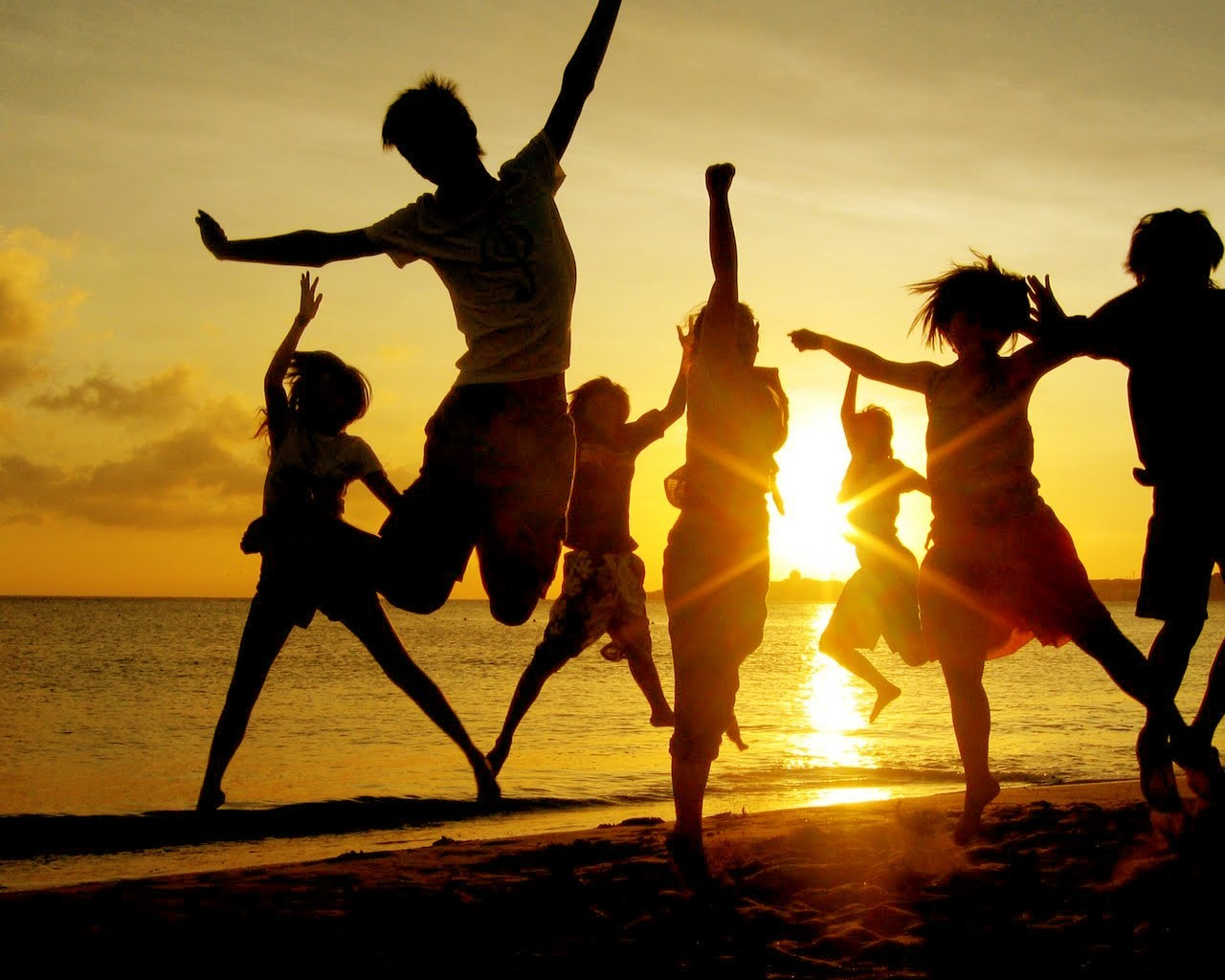 sunset silhouettes jumping arms HD Wallpaper