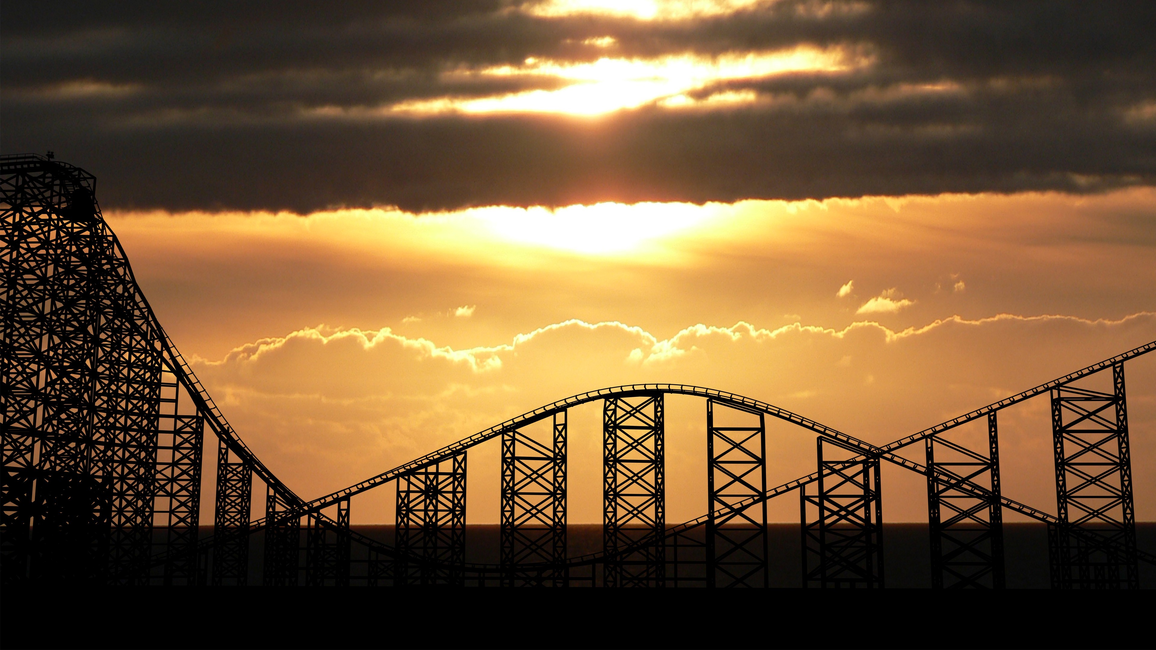 sunset silhouettes roller coasters HD Wallpaper