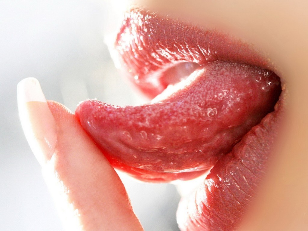 woman close-up mouth tongue