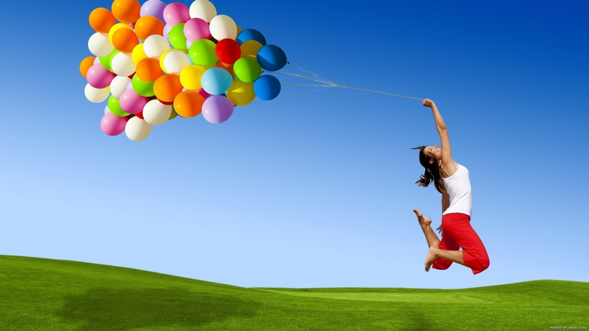 woman jumping Balloons arms