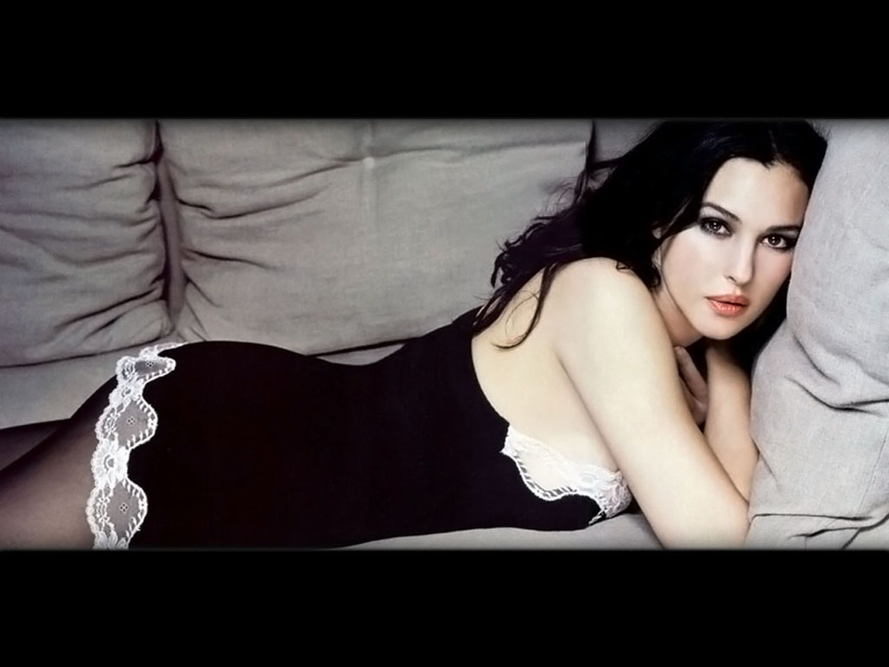 woman Monica Bellucci couch